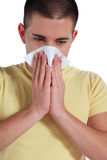 Young man got a cold. Attractive young man got a cold. All isolated on white background Stock Photo