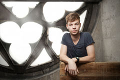 Young man in gothic church. Looking at camera in a gothic church Stock Images