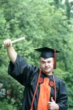 Young man graduating Royalty Free Stock Image