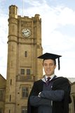 A young man in a graduation gown. Stock Photography