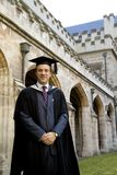 A young man in a graduation gown. Royalty Free Stock Images