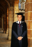 A young man in a graduation gown. Stock Photo