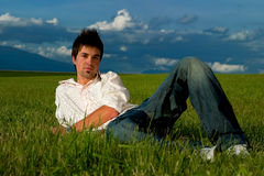 Young man in grass Royalty Free Stock Photo