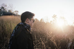 Young man in grass field with sunrise Royalty Free Stock Photos
