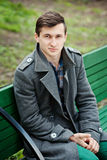 Young man in a gray coat Stock Image