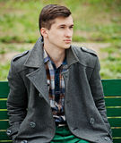 Young man in a gray coat Royalty Free Stock Photography