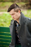 Young man in a gray coat Royalty Free Stock Image