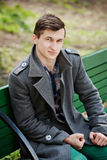 Young man in a gray coat Royalty Free Stock Images