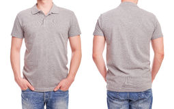 Young man with gray polo shirt. On a white background Stock Photos