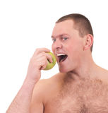 Young man with green apple Royalty Free Stock Image