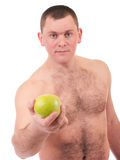 Young man with green apple Stock Photo