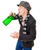 Young man with green bottle Royalty Free Stock Images