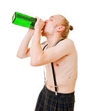 Young man with green bottle Royalty Free Stock Photo