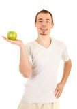 Young man with green fresh apple Royalty Free Stock Photos