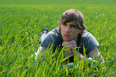 Young Man at the Green Grass Stock Images