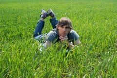 Young Man at the Green Grass Royalty Free Stock Photos