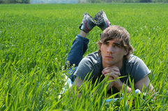 Young Man at the Green Grass Royalty Free Stock Images