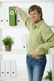 Young man in green office Royalty Free Stock Photos