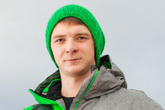 Young man in green. Royalty Free Stock Photography