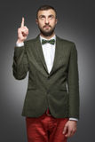 Young man in a green suit, shows up. Young man in a green suit Royalty Free Stock Images