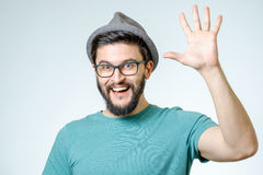 Young man and greeting sign Royalty Free Stock Photography