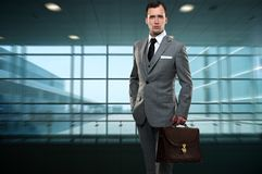Young man in grey suit Stock Photos