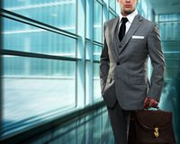 Young man in grey suit Stock Images