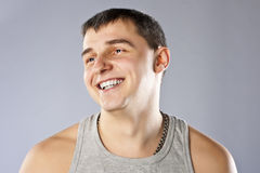 Young man in grey t-shirt studio shot Royalty Free Stock Image