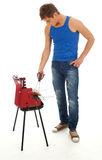 Young man grilling chiken Stock Photo