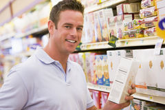 Young man grocery shopping royalty free stock images