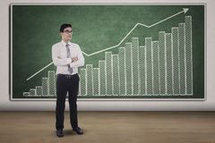 Young man and growing business chart Stock Image