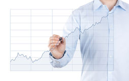 Young man with growing chart Stock Photo