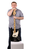Young man with guitar. Isolated on the white Stock Photography