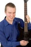 Young man with a guitar Stock Photography