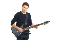 Young man with guitar Stock Images