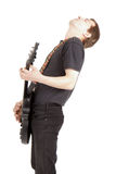Young man with a guitar Royalty Free Stock Image
