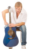 Young man with a guitar Royalty Free Stock Photos