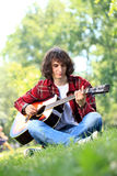 Young man with guitar Royalty Free Stock Image