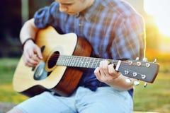 Young man with guitar - closeup Royalty Free Stock Image