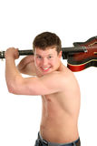 A young man with a guitar in the hands. A young man smile and brandish guitar Stock Photos