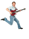 Young man with guitar jumping Royalty Free Stock Photos
