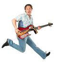 Young man with guitar jumping Royalty Free Stock Image