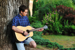 Young man with guitar Royalty Free Stock Photos