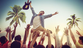 Young Man with a Guitar Performing on a Beach Conc royalty free stock photography