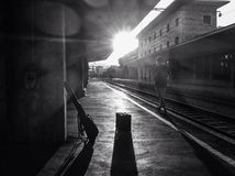 Young man with the guitar. Young man waiting the train Stock Photos