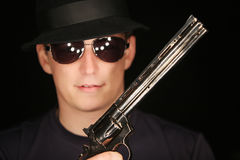 Young man with a gun Royalty Free Stock Images