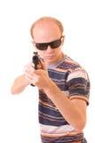 Young man with gun Stock Photos