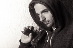 Young Man with a Gun. Black and white image of a caucasian male in a hoodie, holding a gun Stock Photos