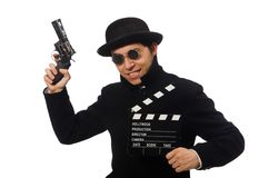 Young man with gun and clapper-board isolated on Royalty Free Stock Image