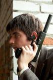 Young man with gun Stock Photo